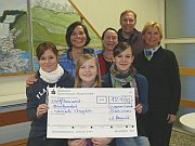 Students with a cheque
